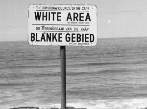 Apartheid is the reason for the o doubt: the apartheid policy is responsible for the racial tensions. The black race is excluded from a lot of places, e.g. at the bayside like indicated on this sign-post. (06/23/76)(AP PHOTO)